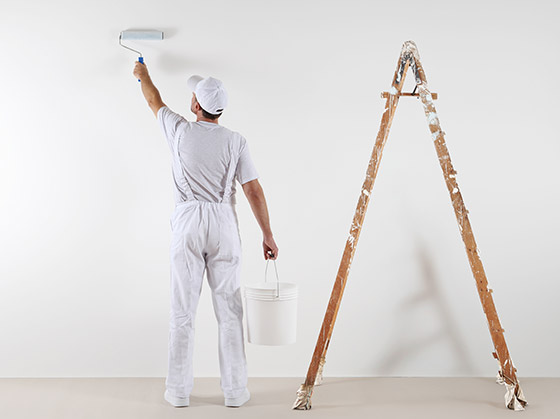 Painter painting an office wall in Ras al Khaimah